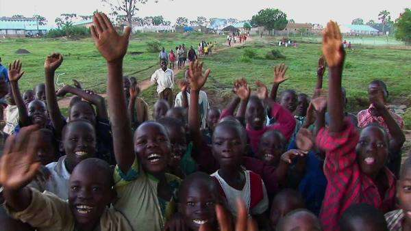 Ugandan refugees wave and cheer towards the camera Royalty-free stock video