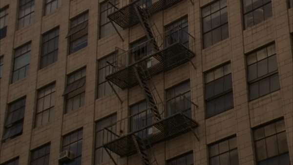 Zoom-in on the fire-escape of a multi-story building. Royalty-free stock video