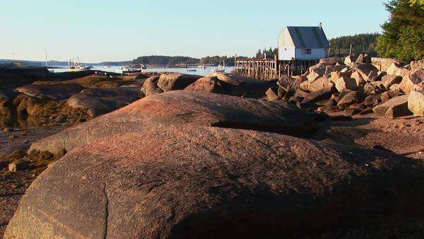 A rocky shore surrounds a beach house. Royalty-free stock video