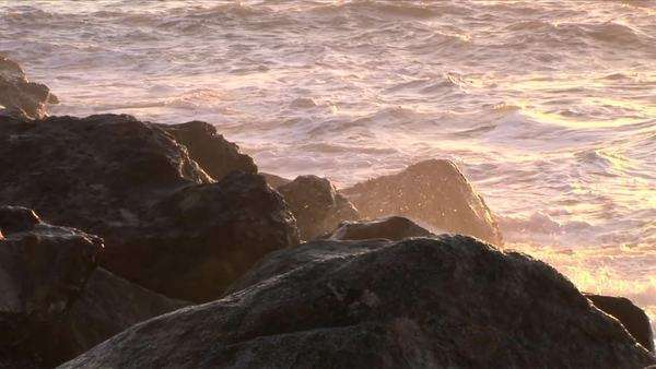 Ocean waves crash onto a rocky shoreline. Royalty-free stock video