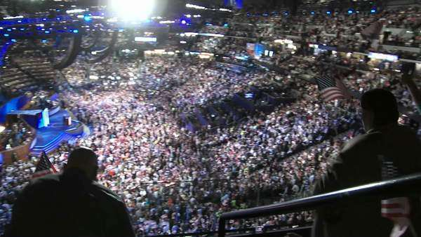 A zoom in to a  shot of Former President Bill Clinton as the crowd boo's at the mention of Republicans during the 2008 Democratic National Convention in Denver, Colorado. Royalty-free stock video