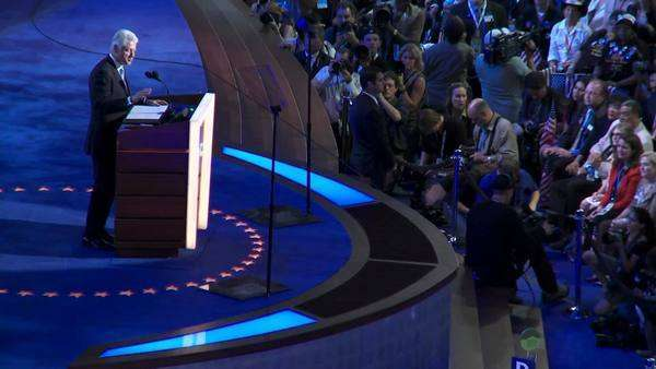 A zoom out to a wide shot of Former President Bill Clinton at the Pepsi Center in Denver Colorado during the 2008 Democratic National Convention. Royalty-free stock video