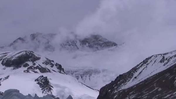 Clouds moving across the North Face of Mt. Everest from a distance Royalty-free stock video