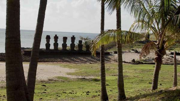Easter Island statues stand in a long row on a distant beach. Royalty-free stock video