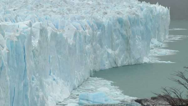 The front of a glacier is crumbling into the sea. Royalty-free stock video