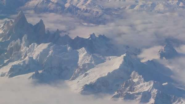 Aerial over the Andes mountain range in patagonia under heavy snow. Royalty-free stock video