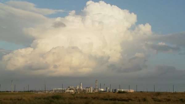 Beautiful timelapse of clouds over an oil refinery. Royalty-free stock video