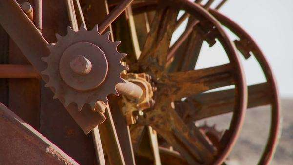 Old cogwheels rust in the sun at an abandoned mine. Royalty-free stock video