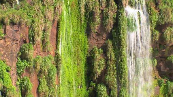 Zoom out from Iguacu Falls in Argentina reveals many rivulets and smaller waterfalls. Royalty-free stock video