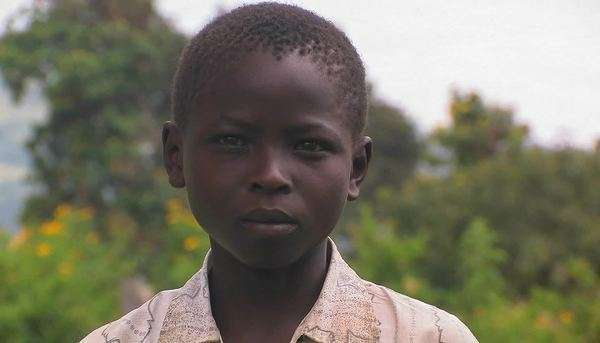 A young African boy with a serious expression on his face. Royalty-free stock video