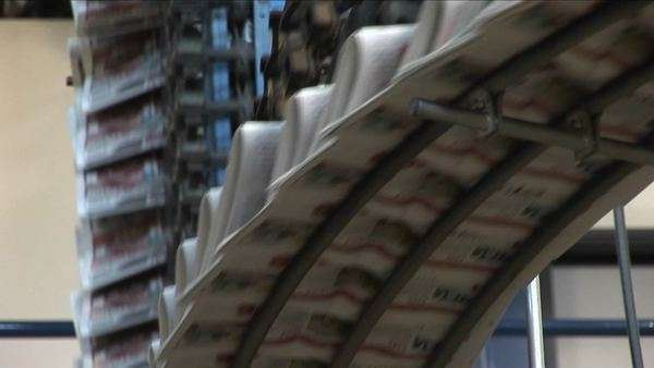 Newspapers move along an assembly line in a factory. Royalty-free stock video