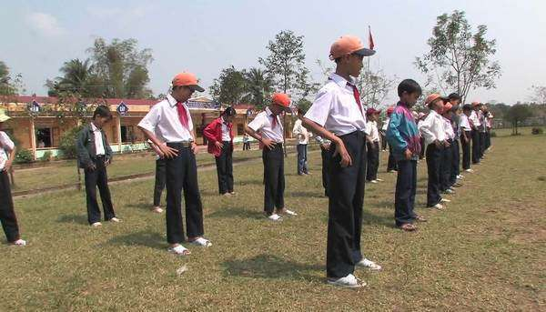 Students of primary school doing exercise in the school playground in China. Royalty-free stock video