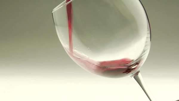Red wine is poured into a goblet. Royalty-free stock video