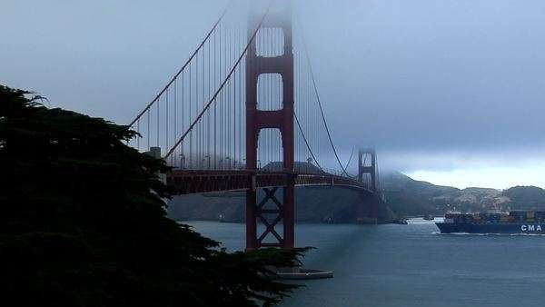 A cargo barge passes under the Golden Gate Bridge. Royalty-free stock video