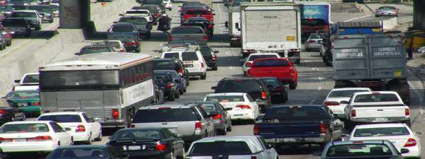 Traffic moves slowly along a busy freeway. Royalty-free stock video