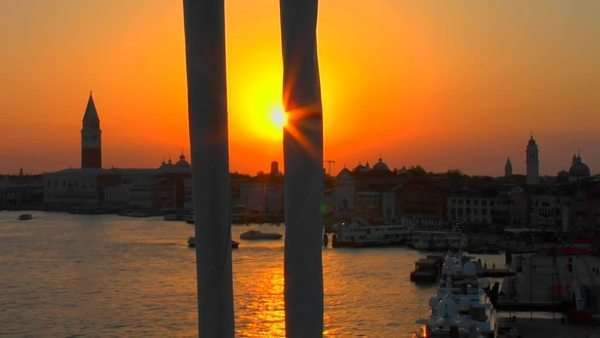 Beautiful silhouetted view of a sunset of Venice, Italy from the mast of a sailboat coming into port. Royalty-free stock video