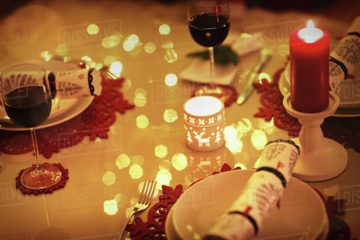 Red Wine And Candles On Ambient Christmas Dinner Table Stock Photo