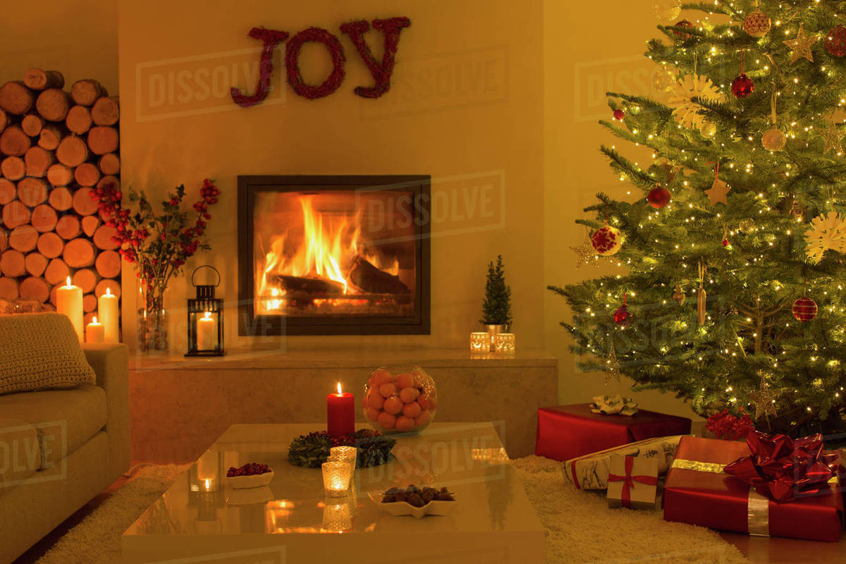 Fireplace Christmas.Ambient Fireplace And Candles In Living Room With Christmas Tree Stock Photo