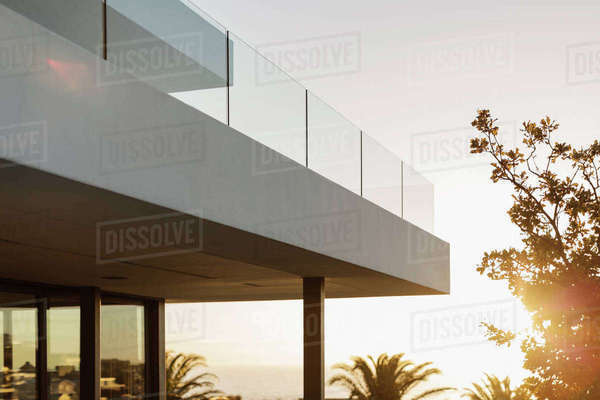 Balcony of modern luxury home showcase exterior at sunset Royalty-free stock photo