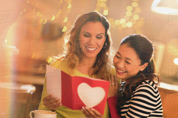 Affectionate lesbian couple with Valentine's Day card Royalty-free stock photo