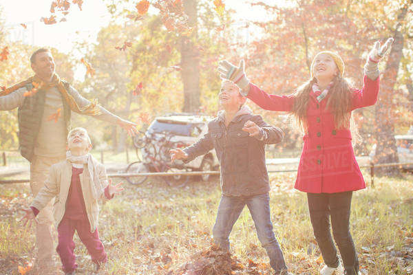 Family playing in autumn park Royalty-free stock photo