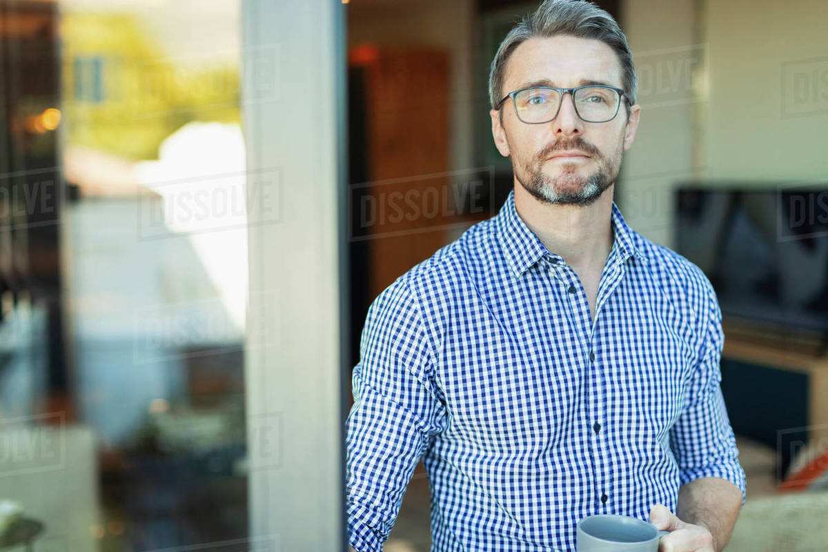Portrait confident businessman drinking coffee in doorway Royalty-free stock photo