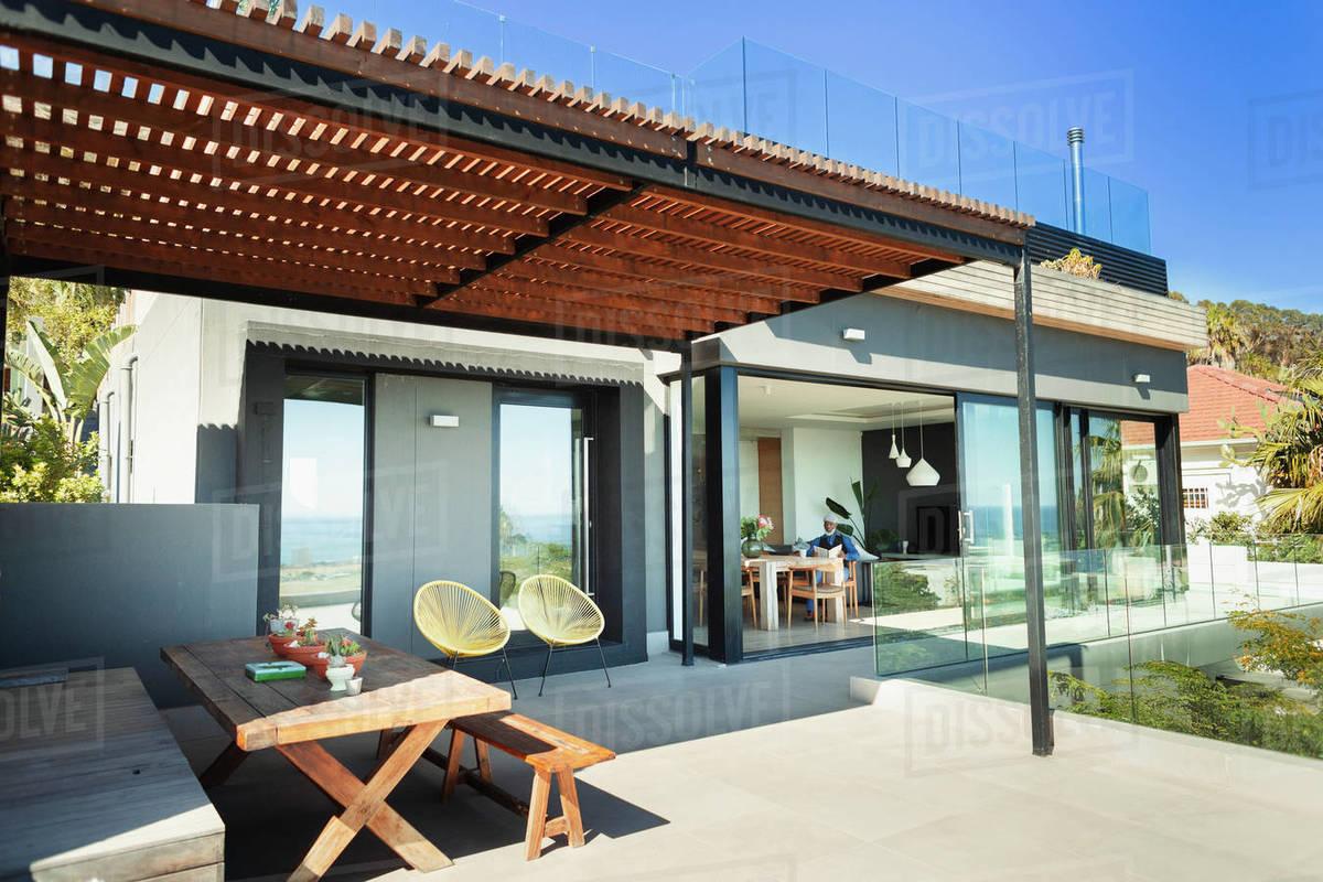 Sunny, modern home showcase patio Royalty-free stock photo