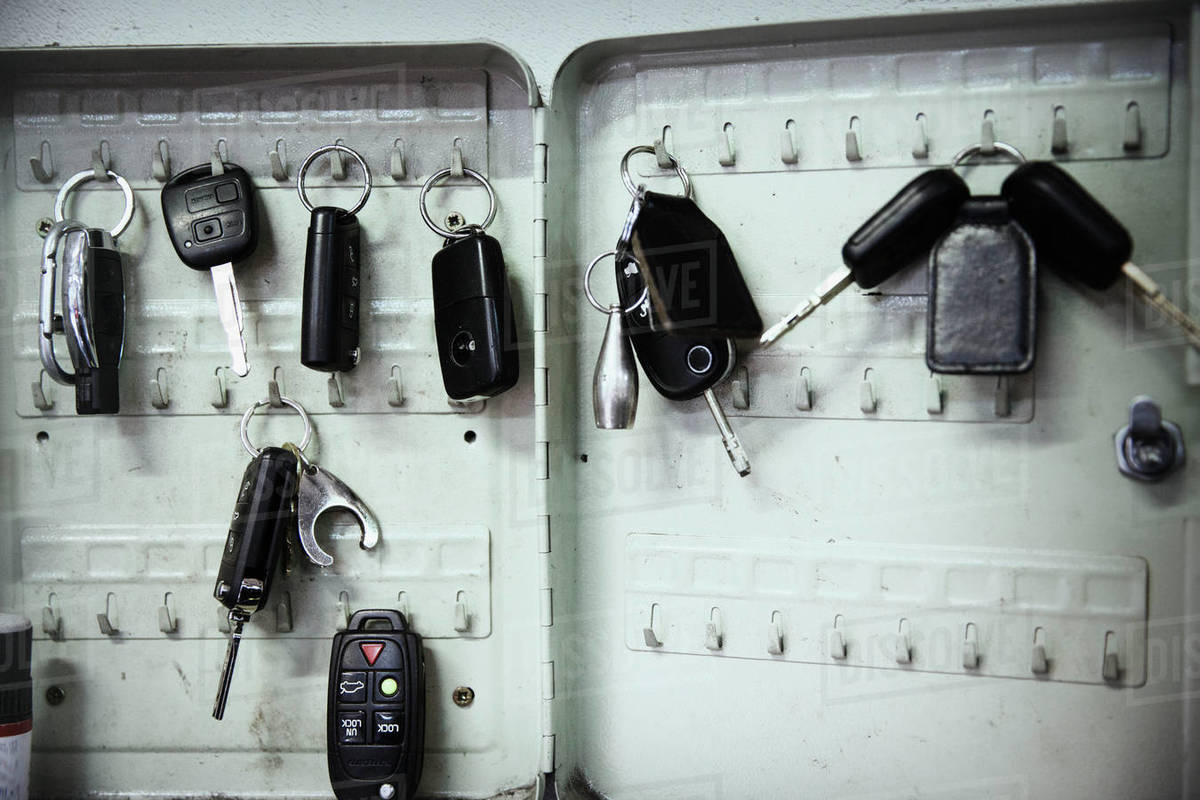 Keys on hooks in auto repair shop Royalty-free stock photo