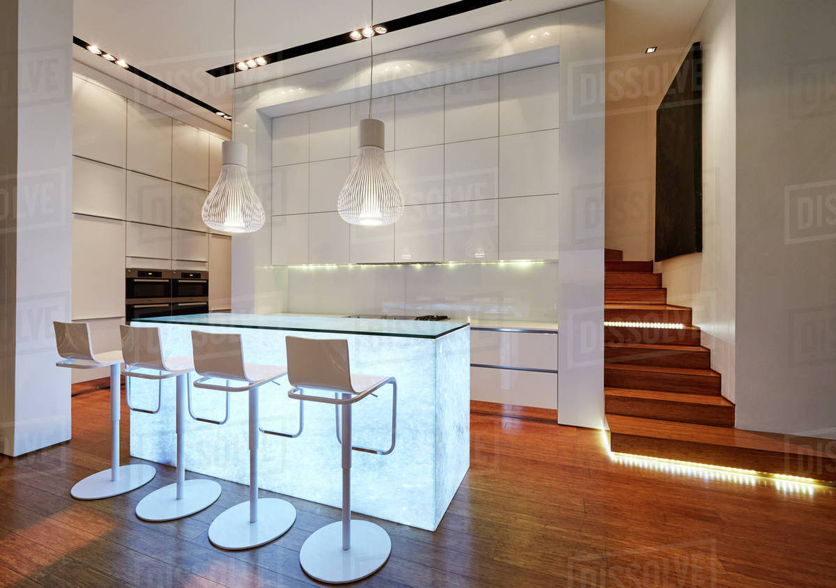 Illuminated Modern Luxury Kitchen And Staircase Stock Photo Dissolve