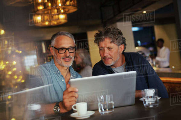 Men using laptop at restaurant Royalty-free stock photo