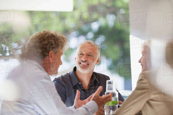 Friends talking and dining in restaurant Royalty-free stock photo