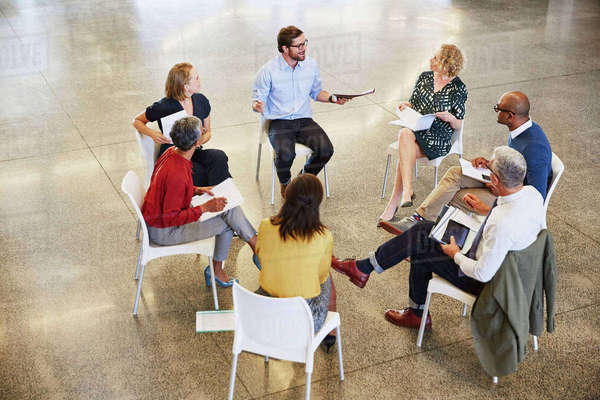 Business people talking in circle meeting Royalty-free stock photo