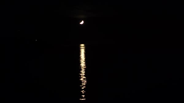 Tracking shot of moonlight reflecting on water surface Royalty-free stock video