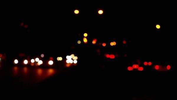 Defocused headlights at night, with bokeh Royalty-free stock video