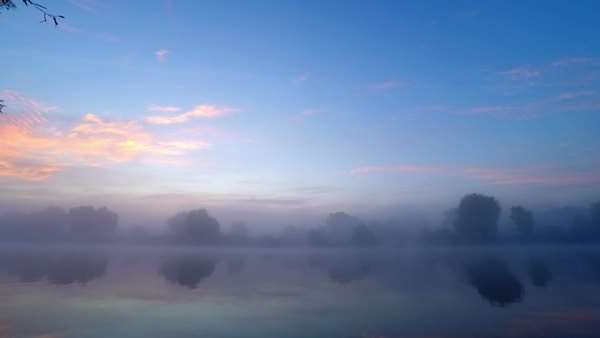 Sunrise reflection with fog rising from flowing river water, timelapse Royalty-free stock video