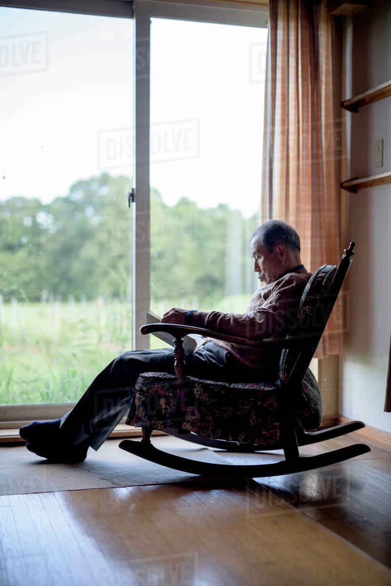 Fabulous Elderly Man Sitting In Rocking Chair By A Window Reading D1024 100 140 Pdpeps Interior Chair Design Pdpepsorg
