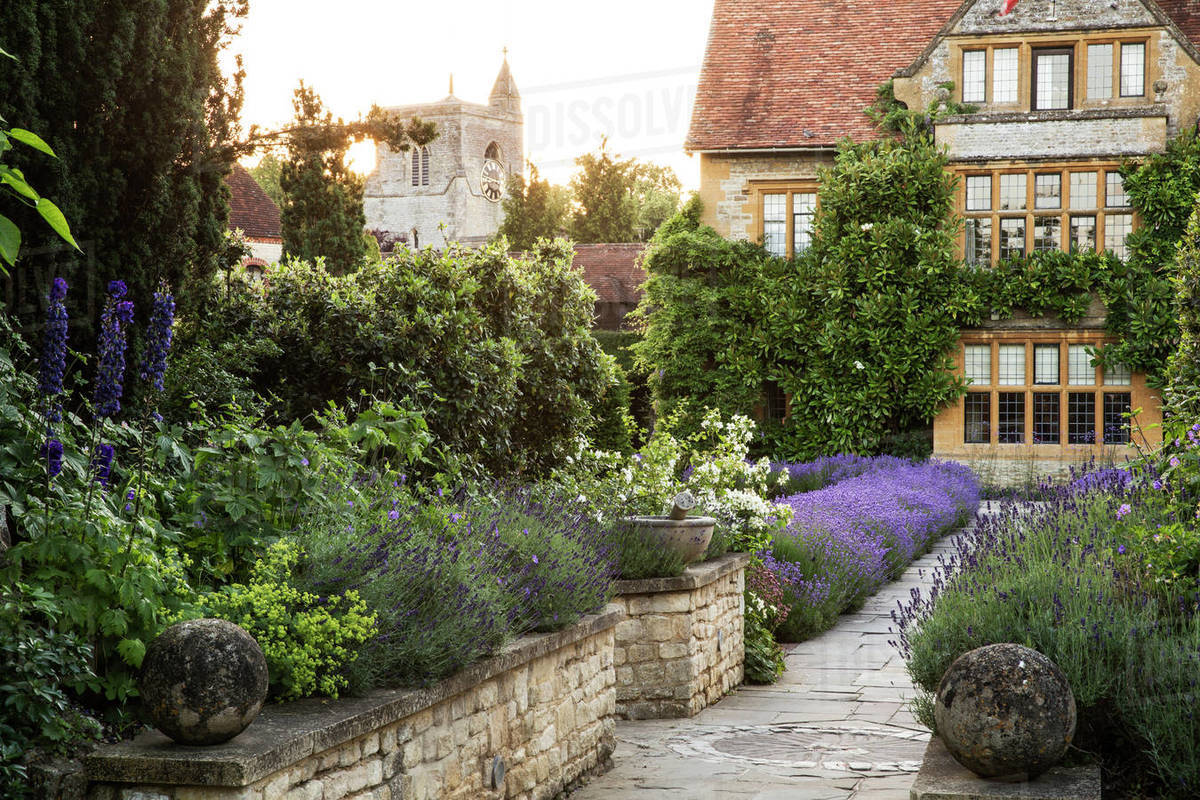 Peachy View Of Historic Manor House From Across A Walled Garden With Path And Flowerbeds Stock Photo Download Free Architecture Designs Rallybritishbridgeorg