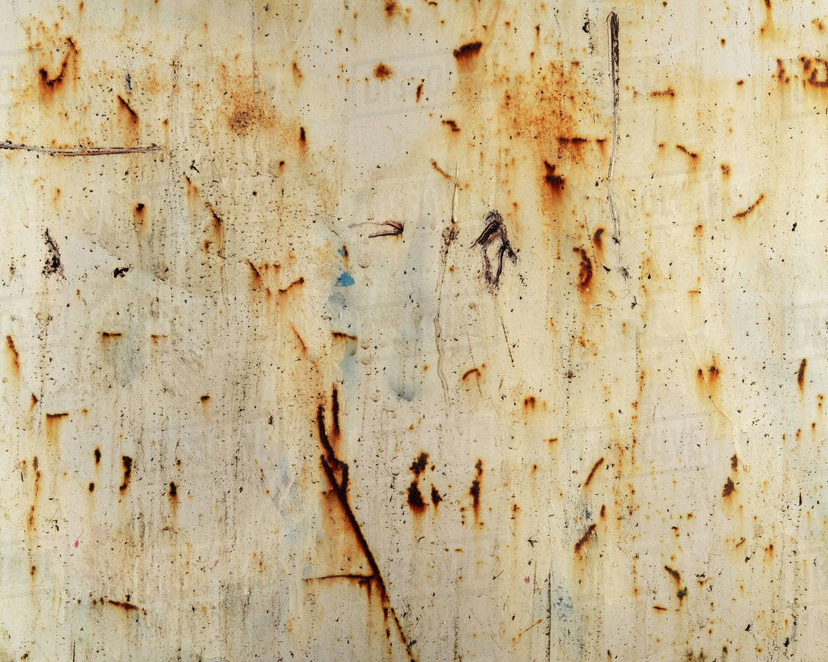 Close up of rusty industrial wall, focus on scratch marks Royalty-free stock photo