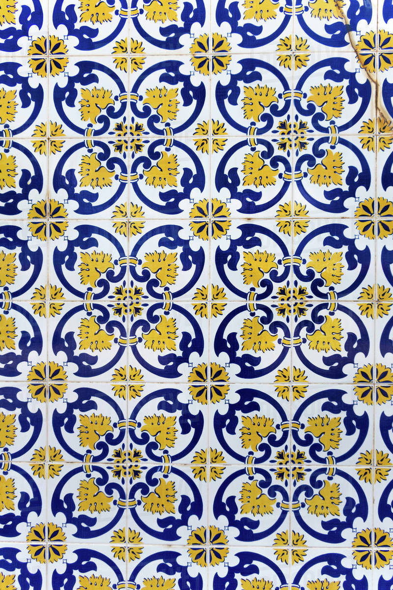 Vintage yellow and blue tiles, Algarve, Portugal Royalty-free stock photo