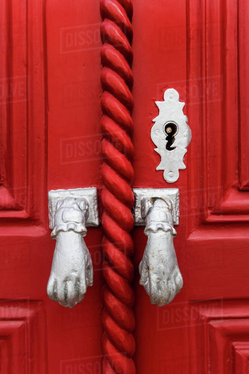 Door knockers in the form of hands, Algarve, Portugal Royalty-free stock photo