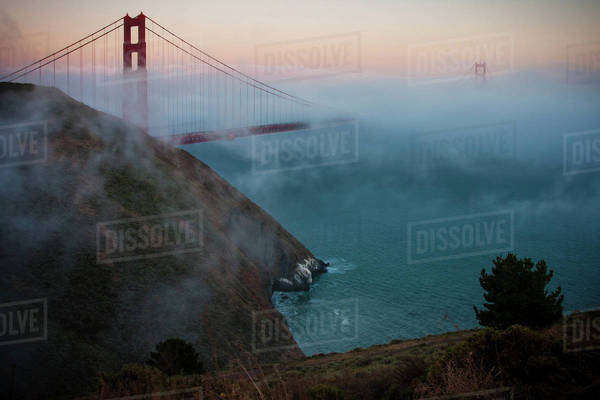 View of the Golden Gate Bridge in San Francisco at sunset in fog. Royalty-free stock photo