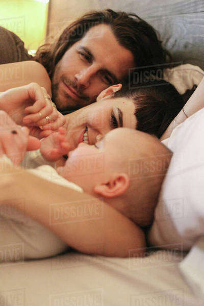 A mother, father and young baby playing at home. Royalty-free stock photo