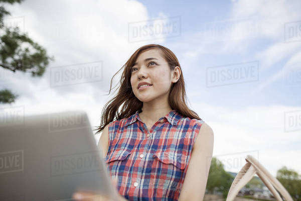Young woman with a digital tablet in the park. Royalty-free stock photo