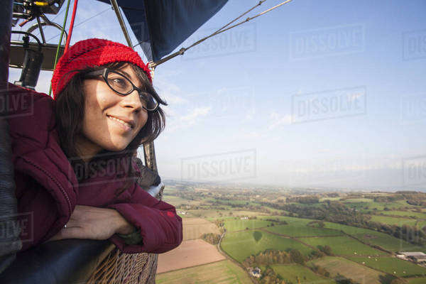 Woman travelling in a hot air balloon.  Royalty-free stock photo