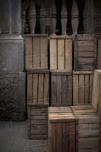 A stack of wooden crates, in the corner of a room.  Royalty-free stock photo