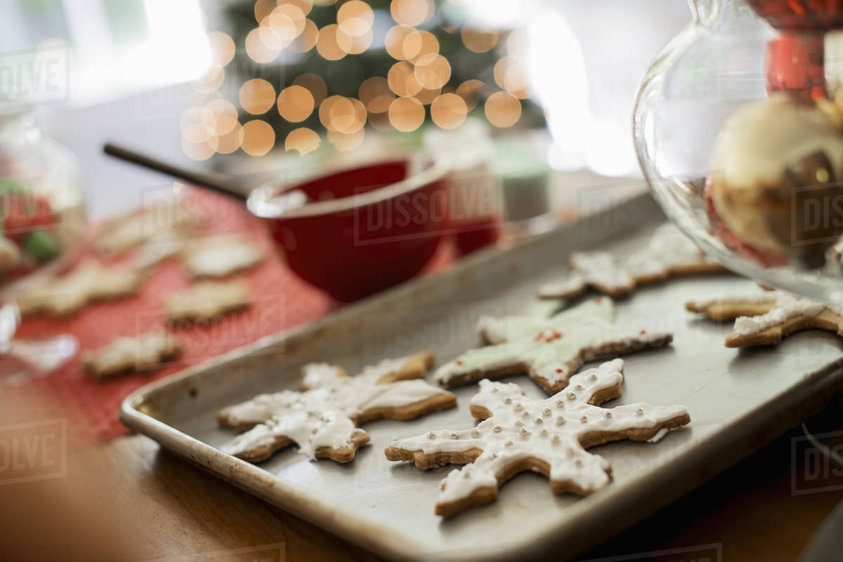 baking tray of organic homemade christmas cookies in the shapes of icicles and stars - Homemade Christmas Cookies