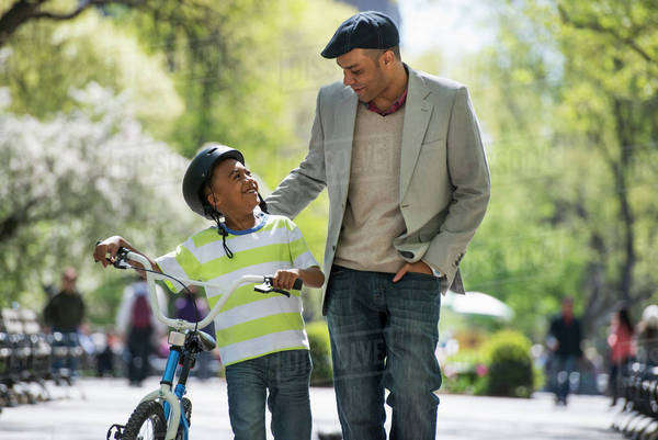 Bicycling And Having Fun. A Father And Son Side By Side. Royalty-free stock photo