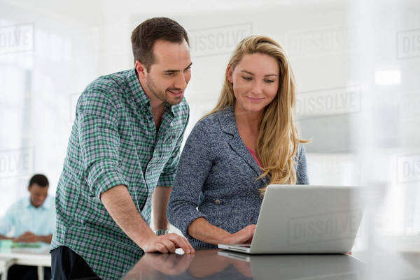 Office Interior. A Couple At A Table Looking At A Computer Screen. Royalty-free stock photo