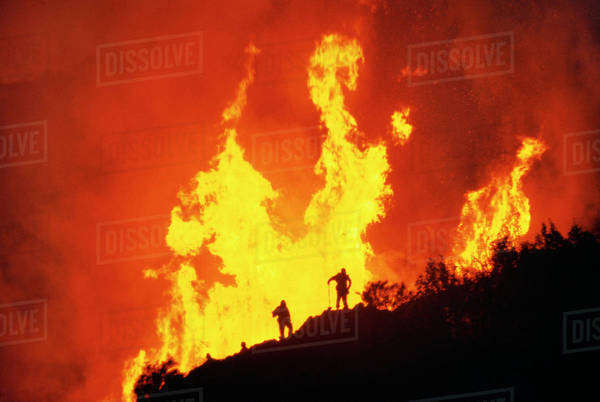 Firefighters and flames, Big Sur, California Rights-managed stock photo