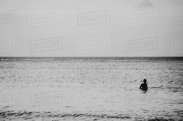 View across the Andaman Sea from Ko Lanta Yai, a person swimming in a vast ocean  Royalty-free stock photo